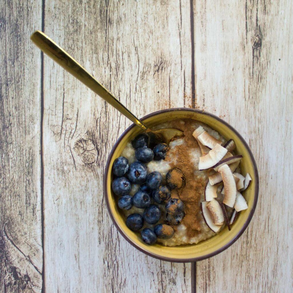 Steel cut oatmeal on a wooden table