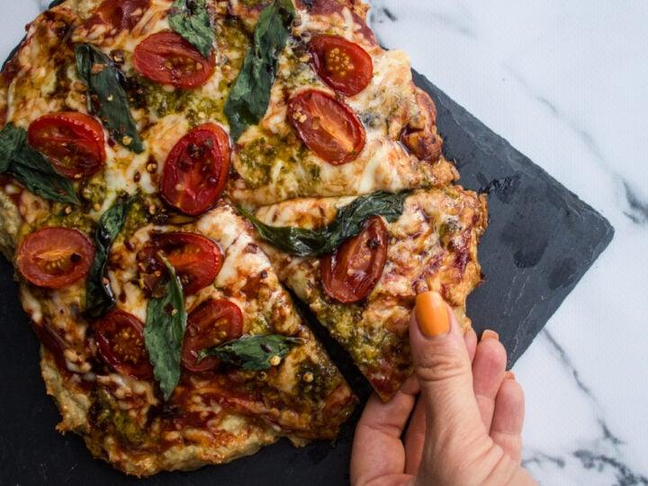chicken crust keto pizza being eaten