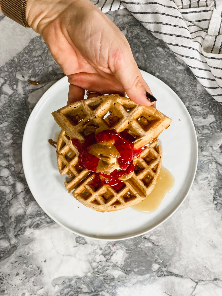 Protein waffle with almond butter, banana, chia jam.