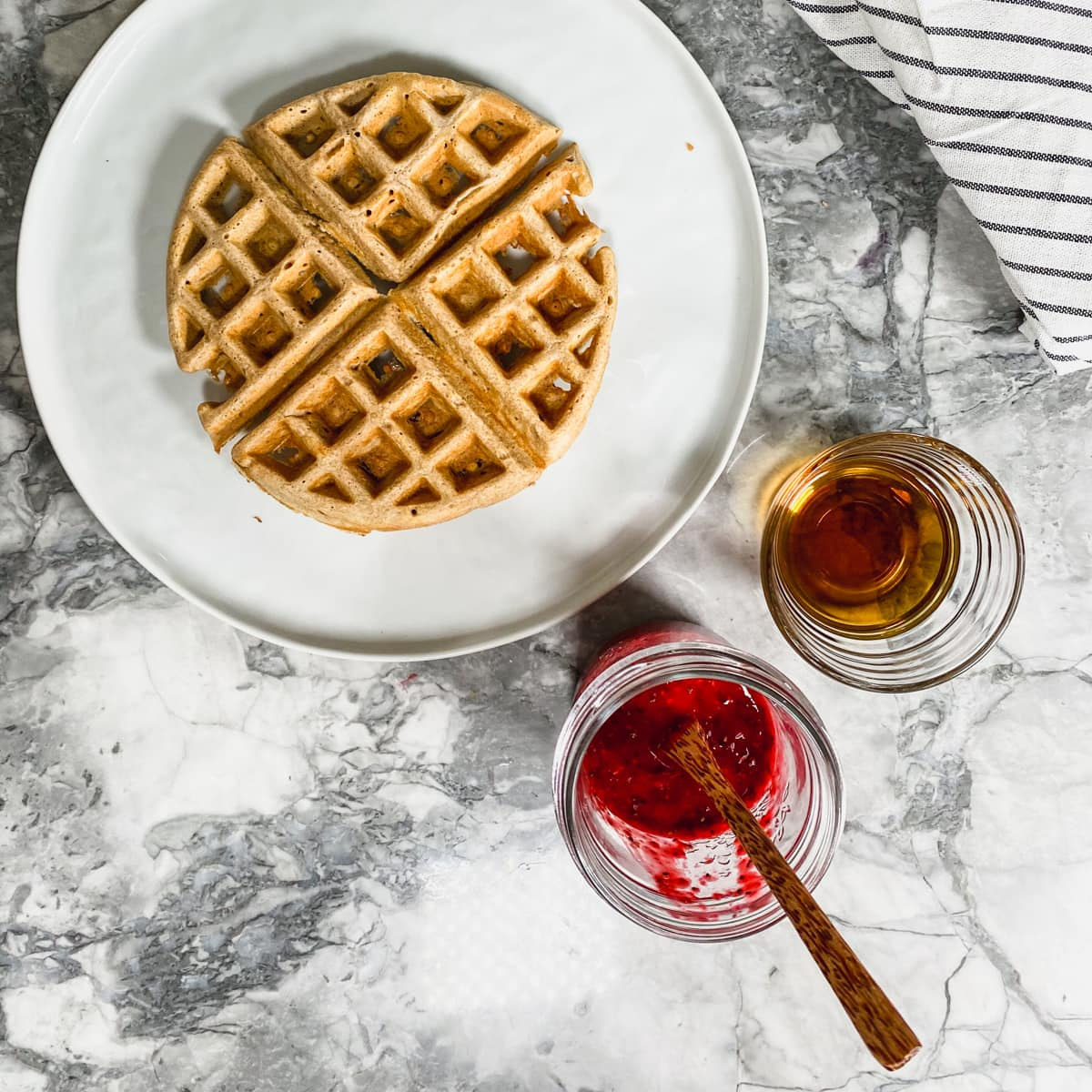 Protein waffle with chia jam and syrup.