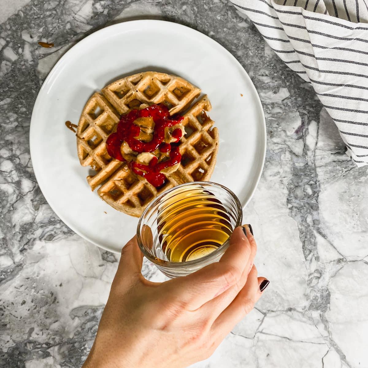 Kodiak Cake waffle with raspberry chia jam.