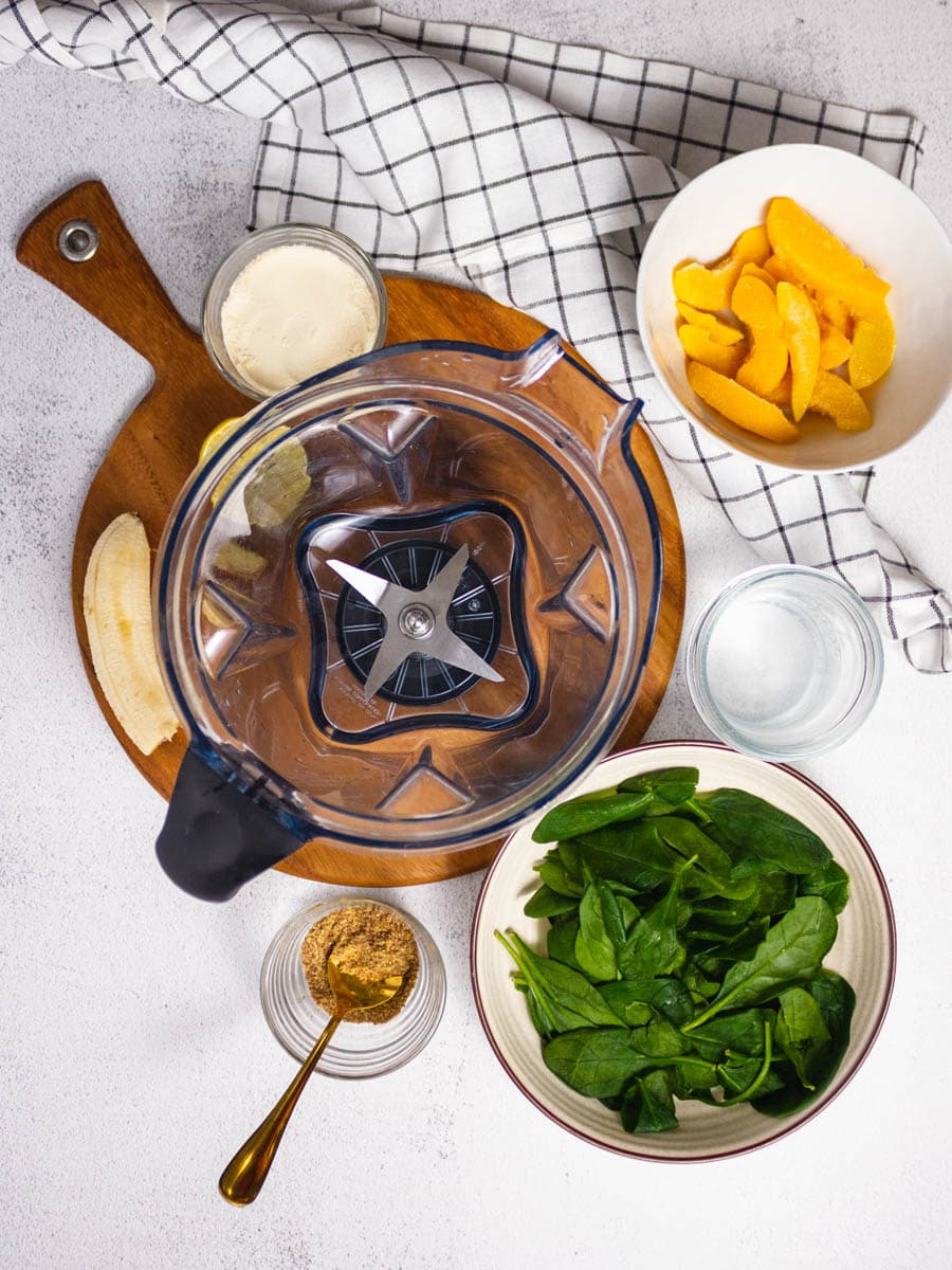 Overhead shot of ingredients required to make the best vanilla protein shake.